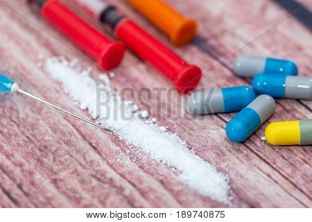 Death Concept - Cocaine Powder, Pills And Syringe