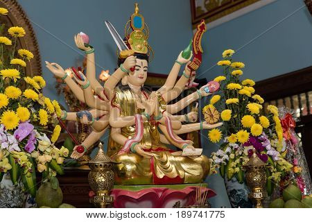 Multiarmed Buddha in the Buddhist temple in Vietnam