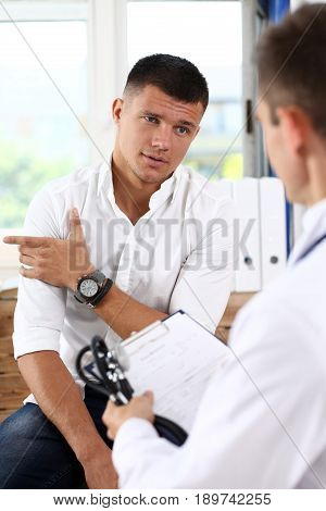 Male Patient Portrait With Doctor Filling Patient History List
