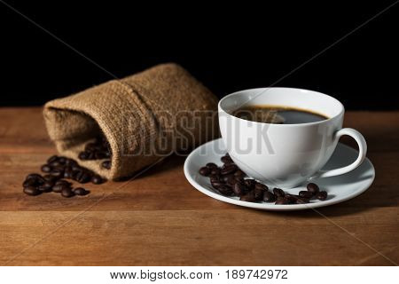 Coffee Cup With Coffee Bean On Brown Wooden Table