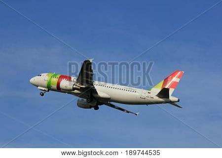 Amsterdam the Netherlands - June 2nd 2017: CS-TNN TAP - Air Portugal Airbus A320 taking off from Polderbaan Runway Amsterdam Airport Schiphol