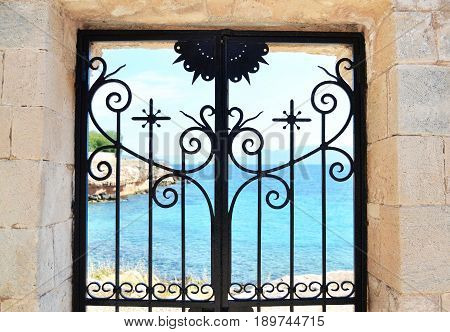 sea behind the door at Aegina island Saronic Gulf Greece