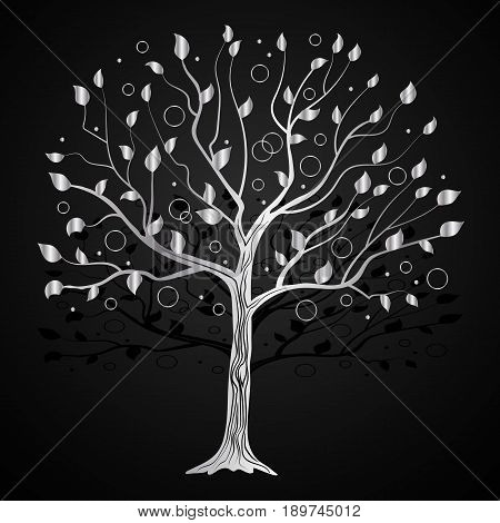 Silver tree with circles on black background.
