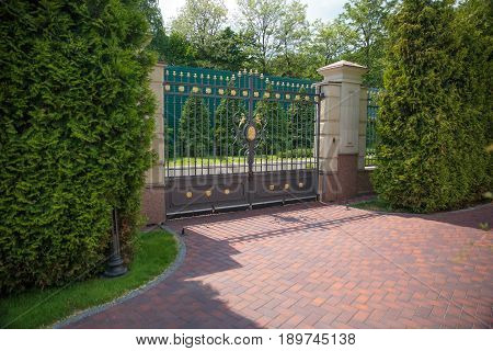 The Closed Forged gates in the summer