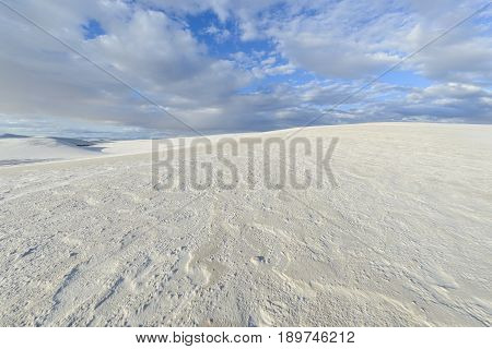Bright White Sand Dunes Shaped by Wind and Rain