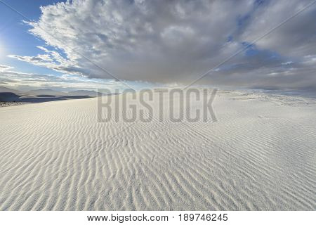 Rippled Pattern in Sand Dunes with Dramatic Clouds