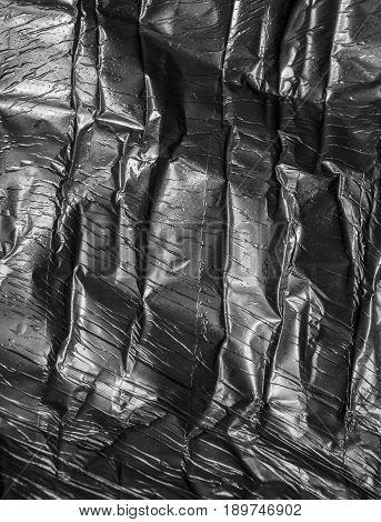 background of black polyethylene. texture . A photo