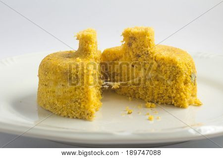 Brazilian Corn Cuscuz on white background. Cuscus