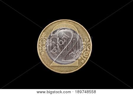 Belorussian two ruble coin on a black background on a black background