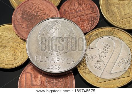 A close up macro shot of Belorussian coins on a black background