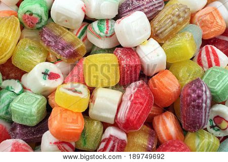 A close up image of assorted classic hard candies
