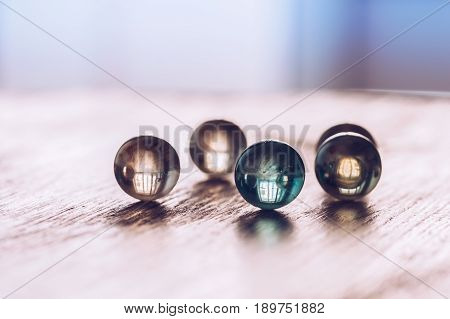 The glass balls on the table. Macro glass beads.Selective focus