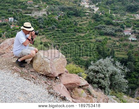 30TH MAY 2017,KABAK,TURKEY: An unknown English tourist taking photos of the beautiful scenery at kabak in turkey, 30th may 2017