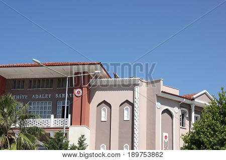 31ST MAY 2017,FETHIYE, TURKEY: An unknown man on the roof of the building containing the court rooms at fethiye in turkey, 31st may 2017