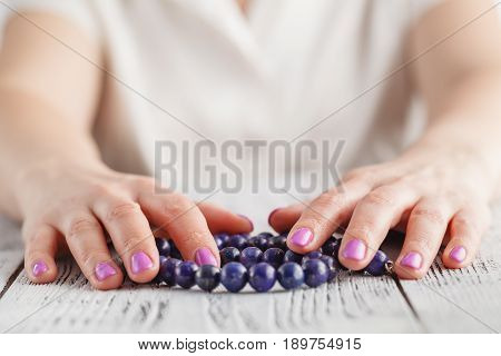 manicure design with lapis lazuli beads and hands