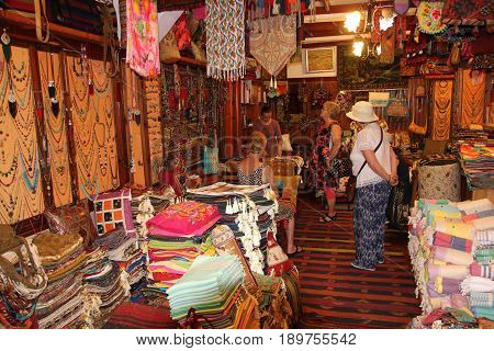 FETHIYE, TURKEY, 31ST MAY 2017:English tourists in a traditional Turkish carpet shop in fethiye, turkey, 31st may 2017