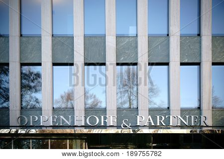 COLOGNE, GERMANY - NOVEMBER 24: The logo of the Economic Chancellery Oppenhoff & Partner at the Institute of German Economy above the entrance on November 24 2016 in Cologne.