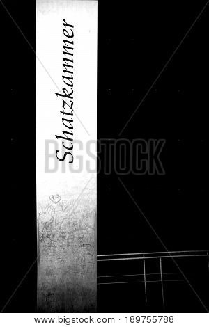 COLOGNE, GERMANY - NOVEMBER 24: The entrance of the cathedral treasury of Cologne cathedral with a stele in front of a black cube on November 24 2016 in Cologne.