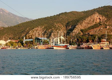 FETHIYE,TURKEY,31ST MAY 2017 :  Turkish pleasure boats moored during early evening in the bay at Fethiye, Turkey , 31st may 2017
