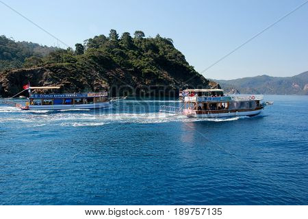 FETHIYE, TURKEY, 1ST JUNE 2017: A diving boat with tourists heading out for a days scuba diving at fethiye in turkey, 1st june 2017