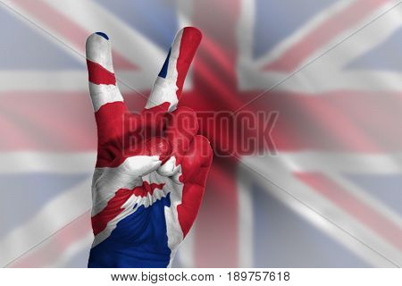 Hand making victory sign, united kingdom painted with flag as symbol of victory,