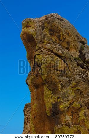 rock against background of blue sky. Russia