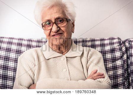 Old woman portrait. senior lady sitting home