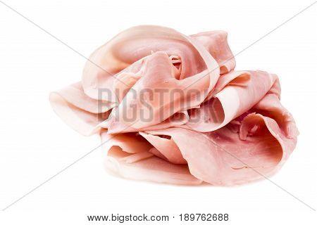 Italian pork ham slices on white background