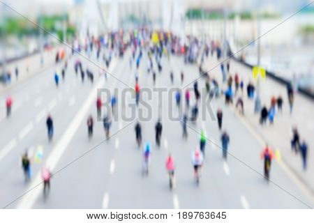 Abstract background of colored group of bicyclists in city center, bike marathon, blur effect, unrecognizable faces. Sport, fitness and healthy lifestyle concept. For backdrop