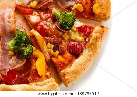 Pizza with beacon, broccoli and corn on white background