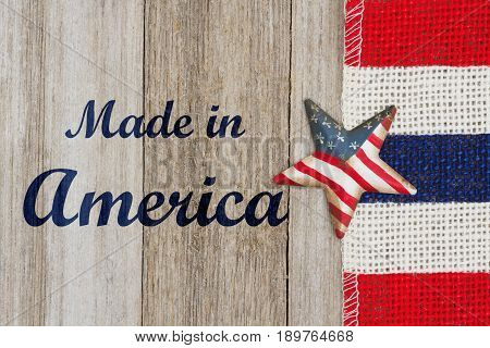 Made in America text with USA flag star with red white and blue pip burlap ribbon on weathered wood