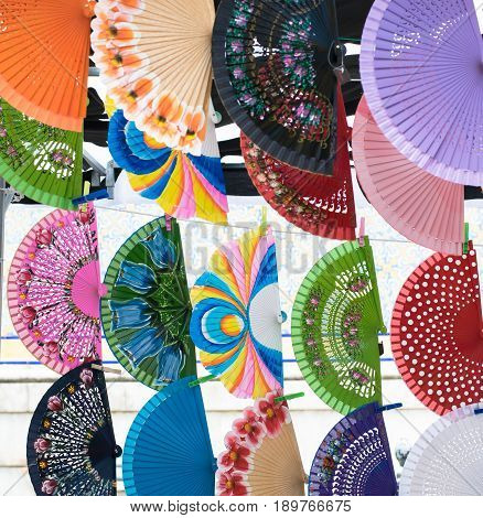Colorful spanish hand fans for sale in a street market.