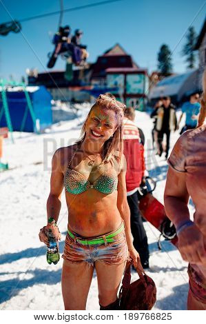 Sheregesh, Kemerovo region, Russia - April 16, 2016: Grelka Fest is a sports and entertainment activity for ski and snowboard riders in bikini. girl in pains holi.