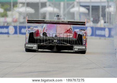 June 02, 2017 - Detroit, Michigan, USA:  The Mazda Motorsports DPI car races through the turns at the Chevrolet Sports Car Classic at Belle Isle Street Course in Detroit, Michigan.