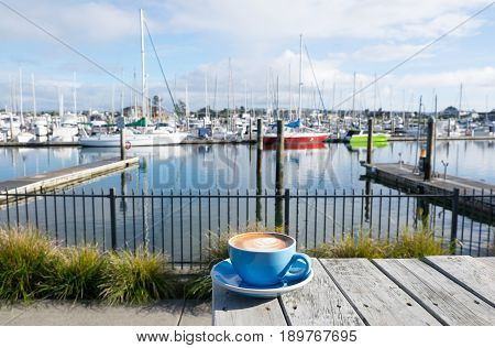 Flat white coffee in a blue cup at Marsden Cove Marina Whangarei New Zealand NZ