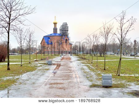 Church in microdistrict Ribatskoe at winter on the outskirts of St. Petersburg Russia. poster
