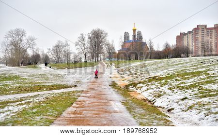 Park and Church in microdistrict Ribatskoe at winter on the outskirts of St. Petersburg Russia.