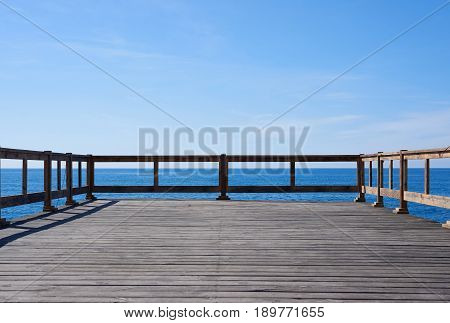 Wooden pier background with copy space for advertising text or windsurfing surfing kiting diving goods. Free place for promotion water travel concept.