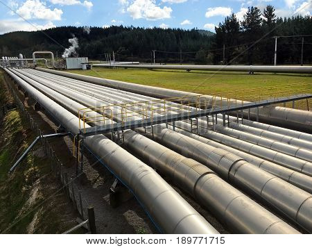 Taupo New Zealand - April 26 2017: Pipes in the Wairakei geothermal power station near Taupo New Zealand. Built in 1958 and it was the first wet steam power station in the world.