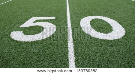 Fifty yard line on an American football field.  Copy Space.