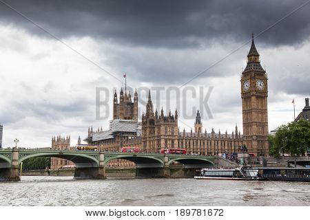 LONDON/UK - MAY 20 : Unidentified tourists travel on a sightseeing boat along the Thames, Big Ben and Westminster Bridge in the background