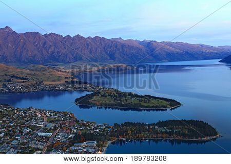 closeup of queenstown with lake Wakatipu from top at dusk.