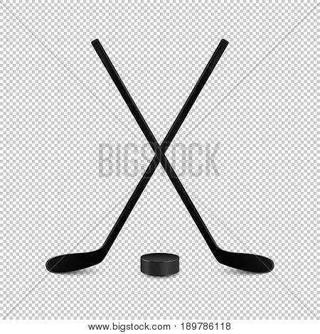 Illustration of sports set - two realistic crossed hockey sticks and puck. Design templates in EPS10 vector. Closeup isolated on transparent background.