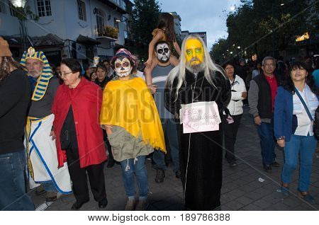 Quito, Ecuador - December 31, 2016: An unidentified group of people wear customs, to celebrate new year in Ecuador.