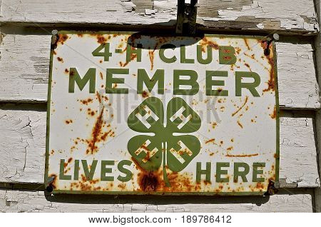 OSAKIS, MINNESOTA, May 28, 2017:  The old sign displays a past member of a 4-H club member, which is a global network of youth organizations whose mission is