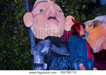 Quito, Ecuador - December 31, 2016: An unidentified woman with a traditional monigotes or stuffed dummies representing political figures, that will get burned to celebrate new year in Ecuador.