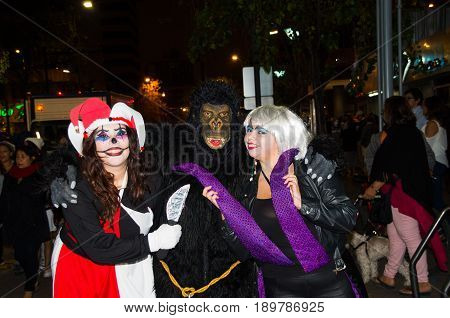 Quito, Ecuador - December 31, 2016: An unidentified group of people wear customs as widowed, king kong and Harley Quin, to celebrate new year in Ecuador.