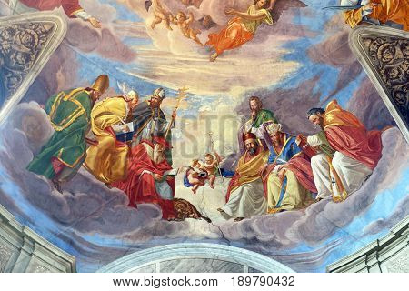 ROME - SEPTEMBER 02: The evangelists and prophets detail of frescoes Apotheosis of St James by Silverio Capparoni on the ceiling of the Church San Giacomo in Augusta in Rome on September 02, 2016.
