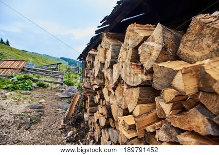 Close up of authentic ukrainian Carpathian village with the stack of firewood