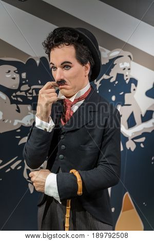 AMSTERDAM, NETHERLANDS - APRIL 25, 2017: Charlie Chaplin wax statue in Madame Tussauds museum on April 25, 2017 in Amsterdam Netherlands.